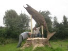 leaping salmon woven from willow in a workshop run by Beryl Smith being installed in Victoria Park, Llanidloes