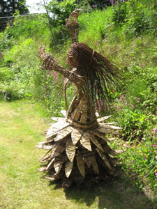 lady woven from willow by Beryl Smith